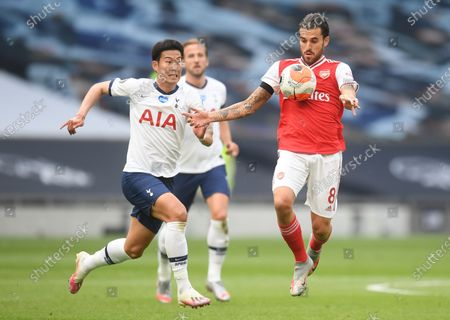 Son Heung-min (L) of Tottenham in action against Dani Ceballos (R) of Arsenal during the English Premier League soccer match between Tottenham Hotspur and Arsenal FC in London, Britain, 12 July 2020.