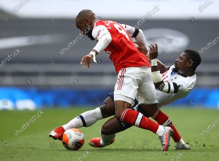 Serge Aurier (back) of Tottenham in action against Alexandre Lacazette (front) of Arsenal during the English Premier League soccer match between Tottenham Hotspur and Arsenal FC in London, Britain, 12 July 2020.