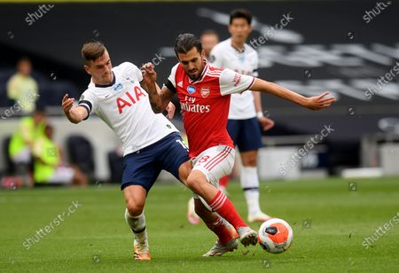 Giovani Lo Celso (L) of Tottenham in action against Dani Ceballos (R) of Arsenal during the English Premier League soccer match between Tottenham Hotspur and Arsenal FC in London, Britain, 12 July 2020.