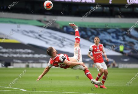 Shkodran Mustafi (L) of Arsenal performs an overhead kick during the English Premier League soccer match between Tottenham Hotspur and Arsenal FC in London, Britain, 12 July 2020.