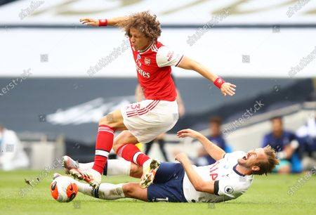Harry Kane (R) of Tottenham in action against David Luiz (L) of Arsenal during the English Premier League soccer match between Tottenham Hotspur and Arsenal FC in London, Britain, 12 July 2020.