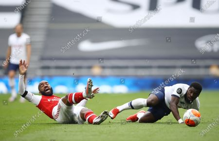 Serge Aurier (R) of Tottenham in action against Alexandre Lacazette (L) of Arsenal during the English Premier League soccer match between Tottenham Hotspur and Arsenal FC in London, Britain, 12 July 2020.