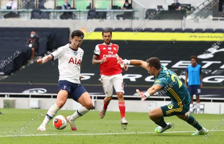 Son Heung-min (L) of Tottenham in action during the English Premier League soccer match between Tottenham Hotspur and Arsenal FC in London, Britain, 12 July 2020.