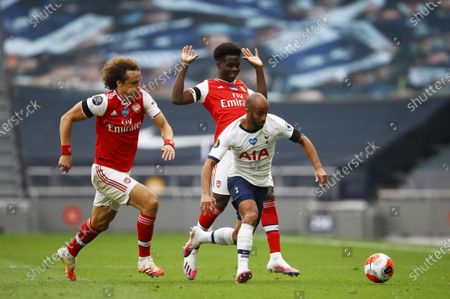 Lucas Moura (R) of Tottenham in action against David Luiz (L) of Arsenal during the English Premier League soccer match between Tottenham Hotspur and Arsenal FC in London, Britain, 12 July 2020.