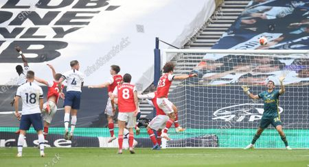 Toby Alderweireld (C-L) of Tottenham scores the 2-1 lead during the English Premier League soccer match between Tottenham Hotspur and Arsenal FC in London, Britain, 12 July 2020.