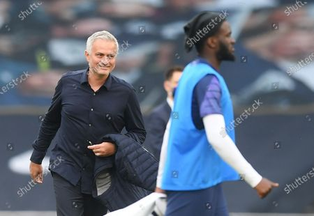 Tottenham's manager Jose Mourinho (L) smiles after the English Premier League soccer match between Tottenham Hotspur and Arsenal FC in London, Britain, 12 July 2020.
