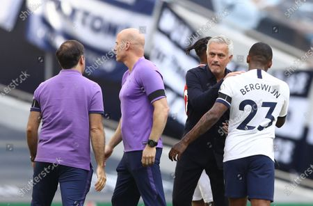 Tottenham's manager Jose Mourinho (2-R) celebrates with Steven Bergwijn (R) after the English Premier League soccer match between Tottenham Hotspur and Arsenal FC in London, Britain, 12 July 2020.