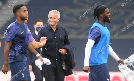 Tottenham's manager Jose Mourinho (C) smiles after the English Premier League soccer match between Tottenham Hotspur and Arsenal FC in London, Britain, 12 July 2020.
