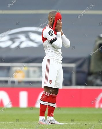 Alexandre Lacazette of Arsenal reacts after the English Premier League soccer match between Tottenham Hotspur and Arsenal FC in London, Britain, 12 July 2020.