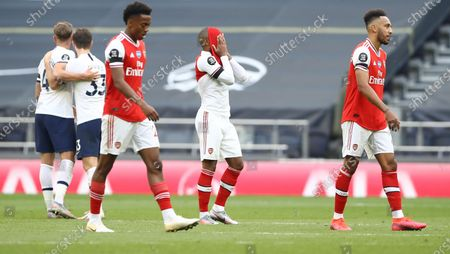 Alexandre Lacazette (C) of Arsenal reacts after the English Premier League soccer match between Tottenham Hotspur and Arsenal FC in London, Britain, 12 July 2020.