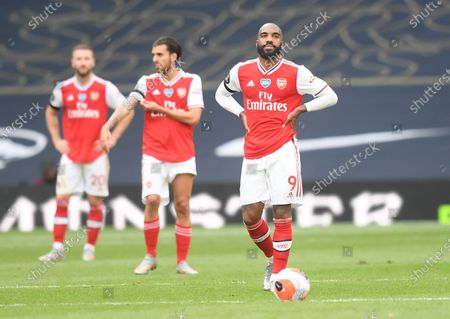 Alexandre Lacazette (R) of Arsenal reacts during the English Premier League soccer match between Tottenham Hotspur and Arsenal FC in London, Britain, 12 July 2020.