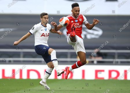 Harry Winks (L) of Tottenham in action against Pierre-Emerick Aubameyang (R) of Arsenal during the English Premier League soccer match between Tottenham Hotspur and Arsenal FC in London, Britain, 12 July 2020.