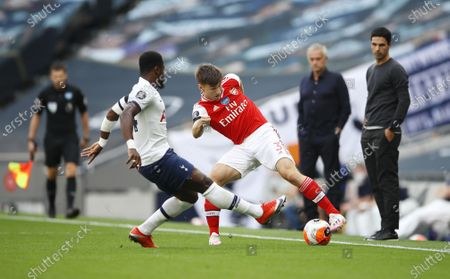 Serge Aurier (L) of Tottenham in action against Kieran Tierney (C) of Arsenal during the English Premier League soccer match between Tottenham Hotspur and Arsenal FC in London, Britain, 12 July 2020.