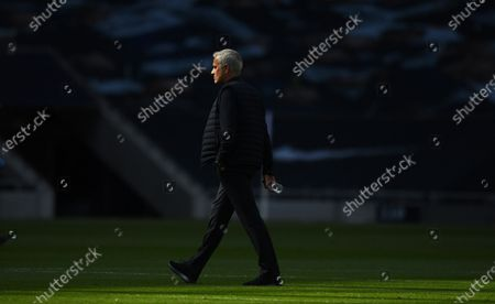 Tottenham's manager Jose Mourinho inspects the pitch prior to the English Premier League soccer match between Tottenham Hotspur and Arsenal FC in London, Britain, 12 July 2020.