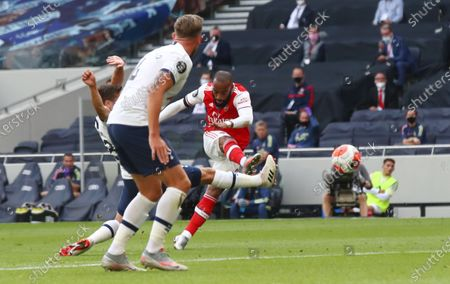 Alexandre Lacazette (R) of Arsenal scores the opening goal during the English Premier League soccer match between Tottenham Hotspur and Arsenal FC in London, Britain, 12 July 2020.