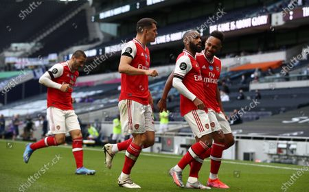 Alexandre Lacazette (2-R) of Arsenal celebrates with teammates after scoring the opening goal during the English Premier League soccer match between Tottenham Hotspur and Arsenal FC in London, Britain, 12 July 2020.