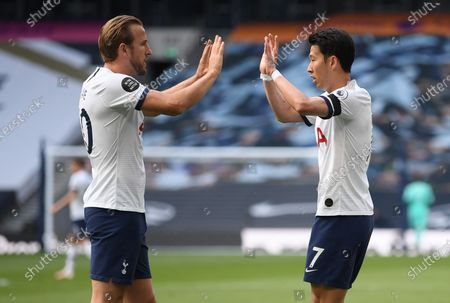 Son Heung-min (R) of Tottenham celebrates with teammate Harry Kane (L) after scoring the 1-1 equalizer during the English Premier League soccer match between Tottenham Hotspur and Arsenal FC in London, Britain, 12 July 2020.