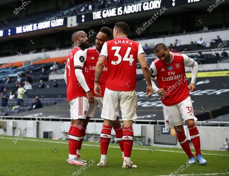 Alexandre Lacazette (L) of Arsenal celebrates with teammates after scoring the opening goal during the English Premier League soccer match between Tottenham Hotspur and Arsenal FC in London, Britain, 12 July 2020.