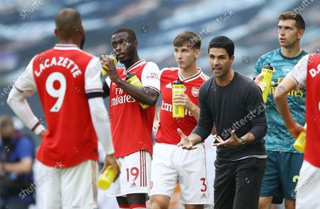 Arsenal's manager Mikel Arteta (2-R) gives instructions to his players during the English Premier League soccer match between Tottenham Hotspur and Arsenal FC in London, Britain, 12 July 2020.