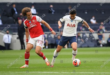 Son Heung-min (R) of Tottenham in action against David Luiz (L) of Arsenal during the English Premier League soccer match between Tottenham Hotspur and Arsenal FC in London, Britain, 12 July 2020.