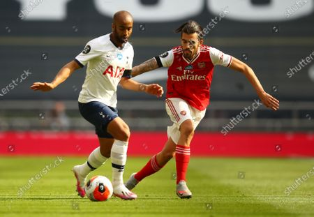 Lucas Moura (L) of Tottenham in action against Dani Ceballos (R) of Arsenal during the English Premier League soccer match between Tottenham Hotspur and Arsenal FC in London, Britain, 12 July 2020.