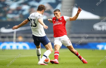 Ben Davies (L) of Tottenham in action against Hector Bellerin (R) of Arsenal during the English Premier League soccer match between Tottenham Hotspur and Arsenal FC in London, Britain, 12 July 2020.