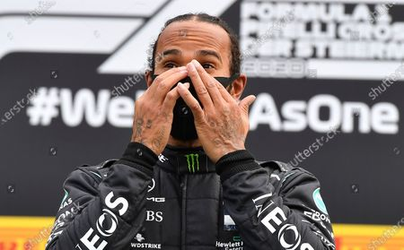 Mercedes driver Lewis Hamilton of Britain celebrates on the podium after winning the Styrian Formula One Grand Prix at the Red Bull Ring racetrack in Spielberg, Austria