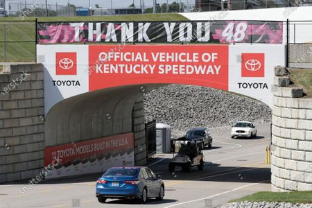 An entrance sign for Kentucky Speedway is decorated with a banner honoring driver Jimmie Johnson before a NASCAR Cup Series auto race, in Sparta, Ky