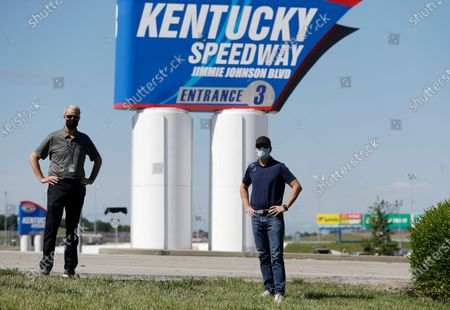 Driver Jimmie Johnson, right, poses with Kentucky Speedway general manager Mark Simendinger in front of a track entrance sign after the street was named for Johnson before a NASCAR Cup Series auto race, in Sparta, Ky