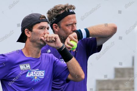 Springfield Laser tennis players, Robert Lindstedt, right, and teammate, Jean-Julien Rojer, left, share strategy during the World TeamTennis tournament at The Greenbrier resort, in White Sulphur Springs, W.Va