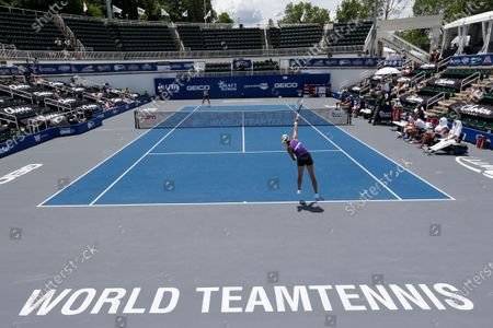 Springfield Laser tennis player Olga Govortsova delivers a serve during the World TeamTennis tournament at The Greenbrier resort, in White Sulphur Springs, W.Va