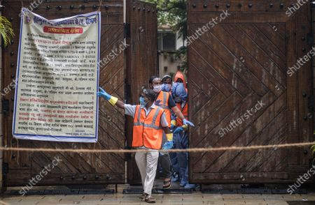 Stock Image of BMC authorities seal and sanitise Amitabh Bachchan's bungalow Jalsa as  Bollywood actors Amitabh Bachchan,  Abhishek,  Aishwarya Rai, and their daughter Aaradhya test postive for COVID-19, on July 12, 2020 in Mumbai, India.