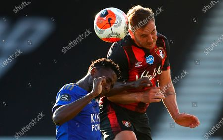 Bournemouth's Dan Gosling (R) in action against Leicester's Wilfred Ndidi (L) during the English Premier League match between AFC Bournemouth and Leicester City in Bournemouth, Britain, 12 July 2020.
