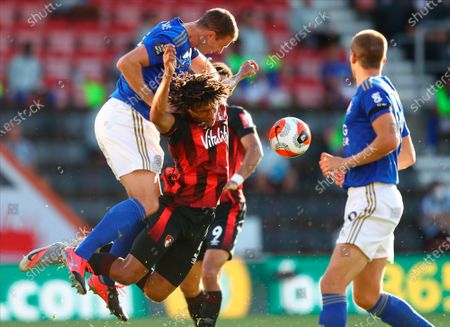 Leicester's Jonny Evans (L) in action against Bournemouth's Nathan Ake (R) during the English Premier League match between AFC Bournemouth and Leicester City in Bournemouth, Britain, 12 July 2020.