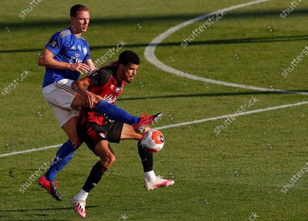 Bournemouth's Dominic Solanke (R) in action against Leicester's Jonny Evans (L) during the English Premier League match between AFC Bournemouth and Leicester City in Bournemouth, Britain, 12 July 2020.