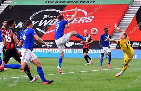 Leicester's Jamie Vardy (C) in action against Bournemouth goalkeeper Aaron Ramsdale (R) during the English Premier League match between AFC Bournemouth and Leicester City in Bournemouth, Britain, 12 July 2020.