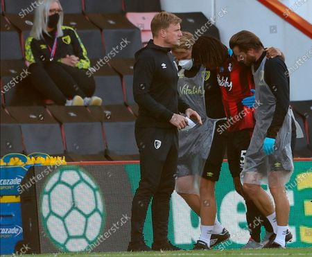 Bournemouth's Nathan Ake (2-R) walks off injured past the Bournemouth manager Eddie Howe (L) during the English Premier League match between AFC Bournemouth and Leicester City in Bournemouth, Britain, 12 July 2020.