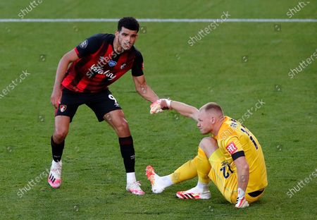 Bournemouth goalkeeper Aaron Ramsdale (R) is helped standing up by Bournemouth's Dominic Solanke (L) during the English Premier League match between AFC Bournemouth and Leicester City in Bournemouth, Britain, 12 July 2020.