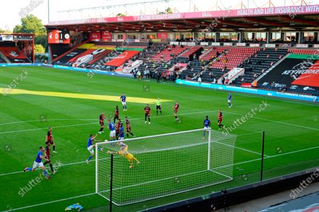 Players of Bournemouth (red) and Leicester (blue) in action in front of empty seats at the Vitality Stadium during the English Premier League soccer match between AFC Bournemouth and Leicester City in Bournemouth, Britain, 12 July 2020.