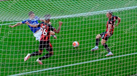 Leicester's Jamie Vardy (L) scores for a 1-0 lead past Bournemouth's Lloyd Kelly (C) and Dan Gosling (R) during the English Premier League match between AFC Bournemouth and Leicester City in Bournemouth, Britain, 12 July 2020.