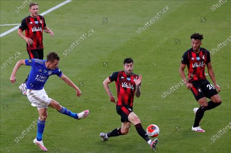 Leicester's Jamie Vardy (L) in action against Bournemouth's Diego Rico (C) during the English Premier League match between AFC Bournemouth and Leicester City in Bournemouth, Britain, 12 July 2020.
