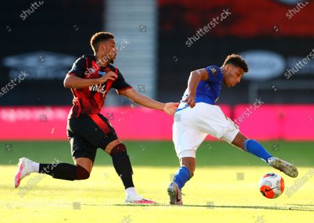 Leicester's James Justin (R) in action against Bournemouth's Arnaut Danjuma Groeneveld (L) during the English Premier League match between AFC Bournemouth and Leicester City in Bournemouth, Britain, 12 July 2020.