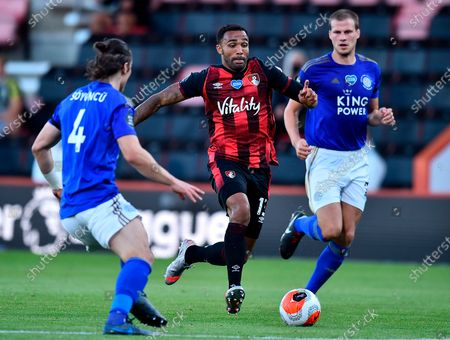 Bournemouth's Callum Wilson (C) in action against Leicester's Caglar Soyuncu (L) during the English Premier League match between AFC Bournemouth and Leicester City in Bournemouth, Britain, 12 July 2020.
