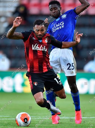Bournemouth's Callum Wilson (L) in action against Leicester's Wilfred Ndidi (R) during the English Premier League match between AFC Bournemouth and Leicester City in Bournemouth, Britain, 12 July 2020.