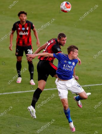 Leicester's Jamie Vardy (R) in action against Bournemouth's Steve Cook (L) during the English Premier League match between AFC Bournemouth and Leicester City in Bournemouth, Britain, 12 July 2020.