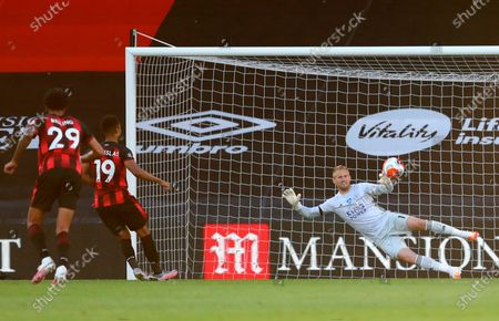 Bournemouth's Junior Stanislas (2-L) scores a penalty kick for a 1-1 draw during the English Premier League match between AFC Bournemouth and Leicester City in Bournemouth, Britain, 12 July 2020.