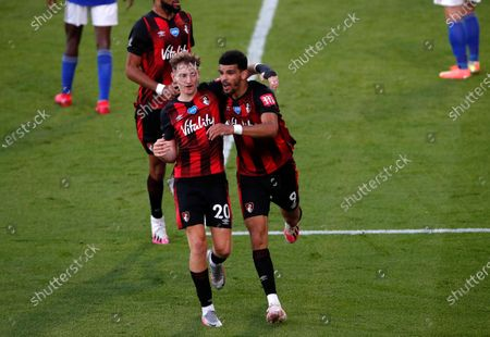 Bournemouth's Dominic Solanke (R) celebrates after scoring for a 2-1 with Bournemouth's David Brooks (L) during the English Premier League match between AFC Bournemouth and Leicester City in Bournemouth, Britain, 12 July 2020.