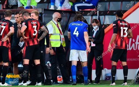 Leicester's Caglar Soyuncu (C) walks off the pitch after being shown a red card during the English Premier League match between AFC Bournemouth and Leicester City in Bournemouth, Britain, 12 July 2020.