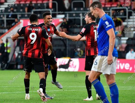 Bournemouth's Dominic Solanke (L), Junior Stanislas (C) and Jack Stacey (R) celebrate his team's fourth goal, an own goal by Leicester, during the English Premier League match between AFC Bournemouth and Leicester City in Bournemouth, Britain, 12 July 2020.