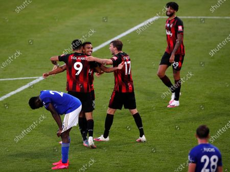 Bournemouth's Dominic Solanke (L), Junior Stanislas (C) and Jack Stacey (R) celebrate their team's fourth goal, an own goal by Leicester, during the English Premier League match between AFC Bournemouth and Leicester City in Bournemouth, Britain, 12 July 2020.